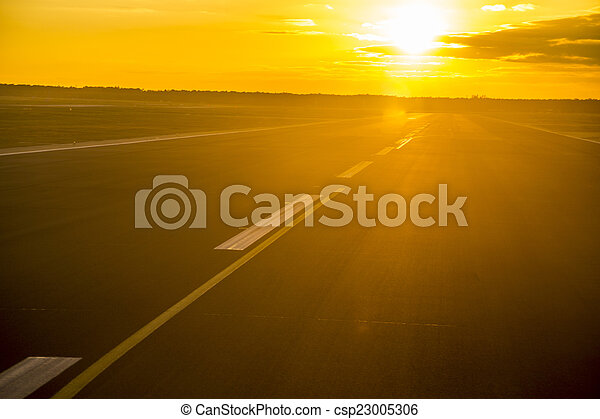 sunset with reflections at the runway - csp23005306