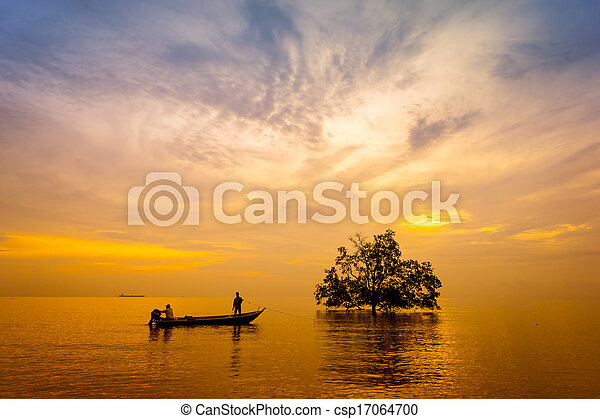 sunset with silhouette and dramatic sky - csp17064700