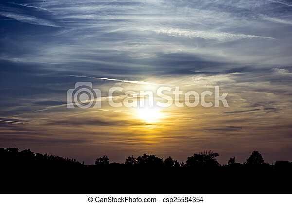 sunset with silhouettes of trees - csp25584354
