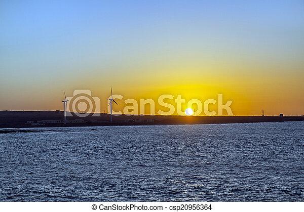 sunset with wind power generators in Fuerteventura at the ocean - csp20956364
