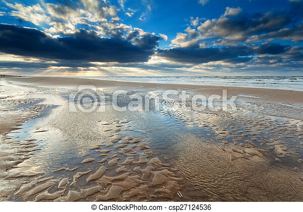 sunshine over North sea beach at low tide - csp27124536
