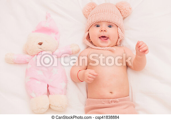 fe72ac22148 Super excited five months old baby girl with teddy bear. Super ...