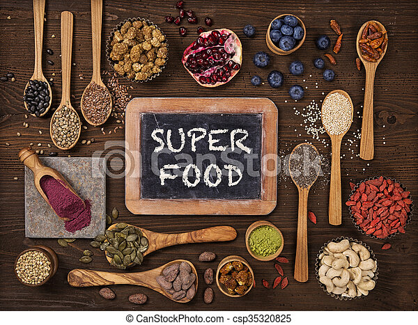 Super foods in spoons and bowls - csp35320825
