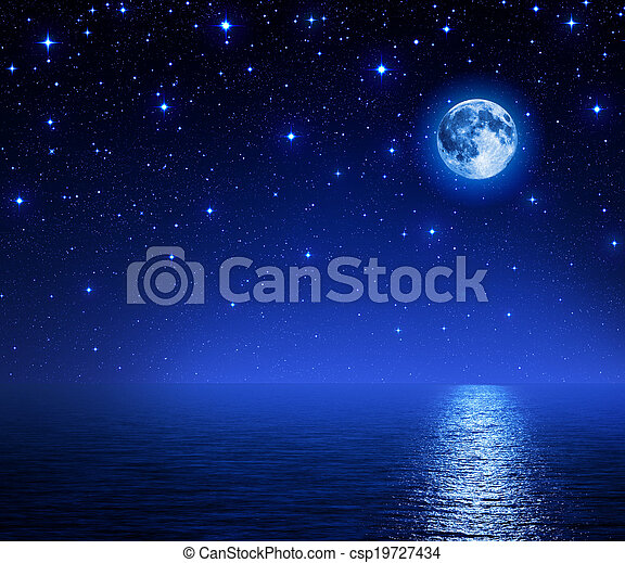 super moon in starry sky on sea - csp19727434