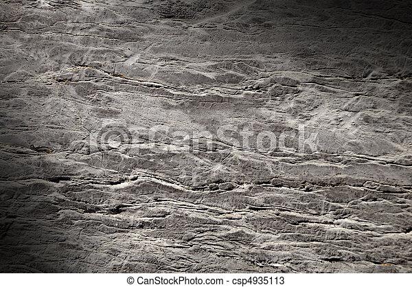 La textura de roca rota iluminada diagonalmente - csp4935113