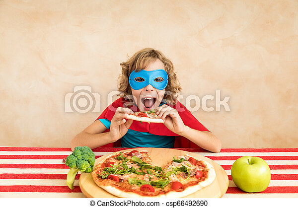 Superhero child eating superfood - csp66492690