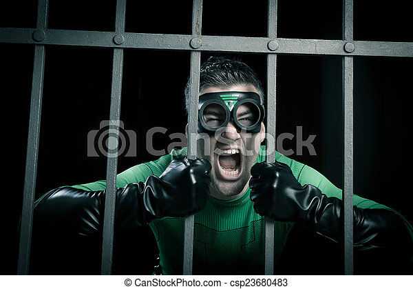 Superhero locked in prison - csp23680483