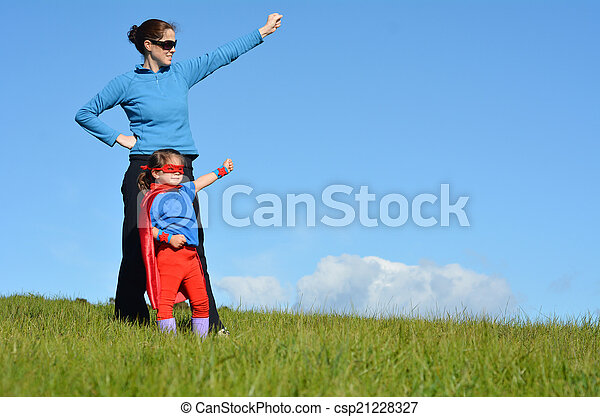 Superhero mother and child - girl power - csp21228327
