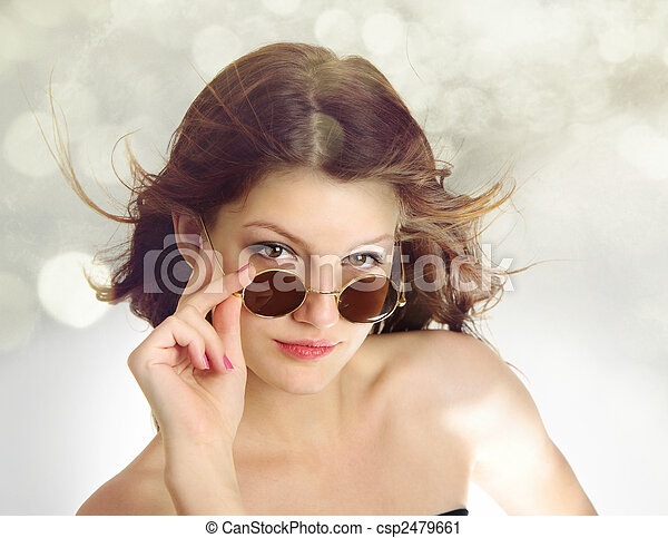 Superior funky look of teenage girl with hair in the wind and vintage glasses isolated on white background - csp2479661