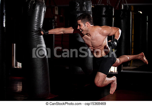Superman punch at the gym - csp15368469