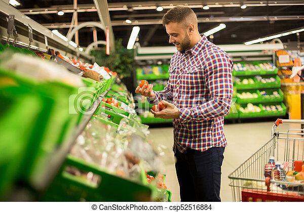 Un Hombre Apuesto Eligiendo Tomates Frescos En El Supermercado Retrato De Vista Lateral De Un Joven Sonriente Eligiendo Canstock Nosotros los guapos is a mexican sitcom that premiered on blim on august 19, 2016. un hombre apuesto eligiendo tomates