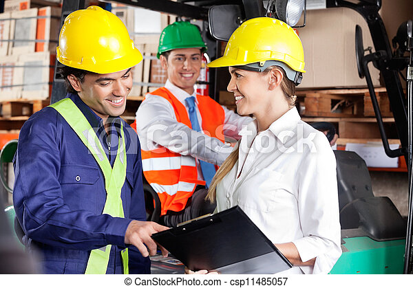 Supervisor Communicating With Foreman At Warehouse - csp11485057