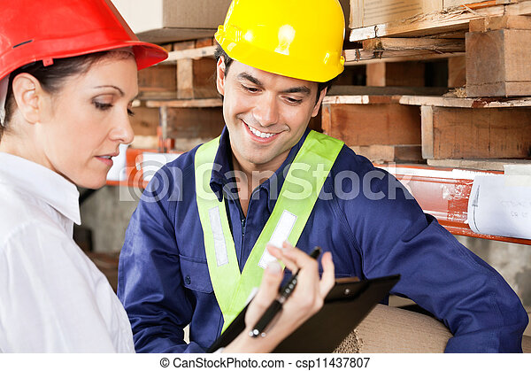 Supervisor Showing Clipboard To Foreman - csp11437807