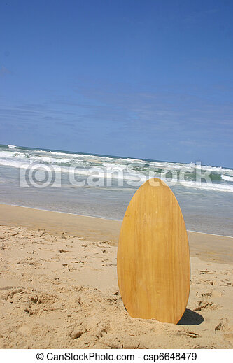 surf board standing on beach a surf board standing in the sand
