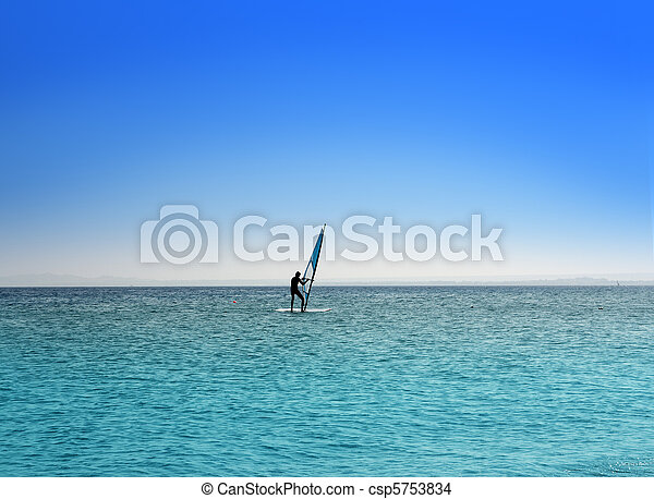 surfer on blue sea under sky - csp5753834