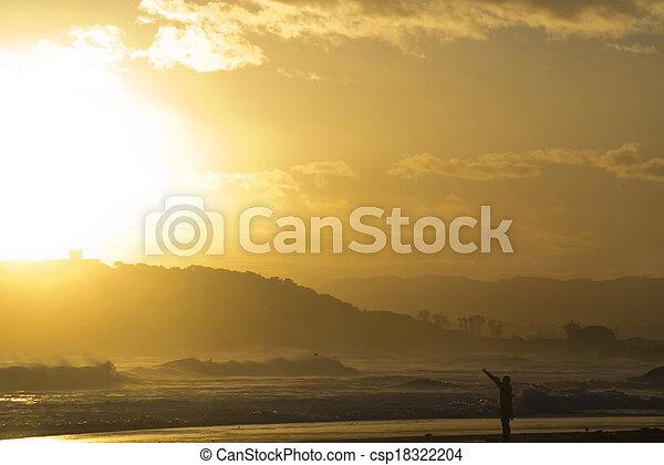 surfer silhouette at dawn - csp18322204
