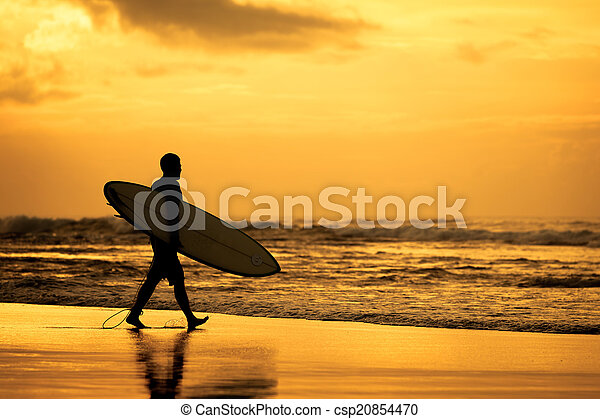 surfer silhouette during sunset - csp20854470