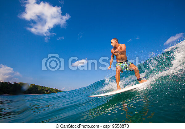 Surfing a Wave. GLand Surf Area. Indonesia. - csp19558870
