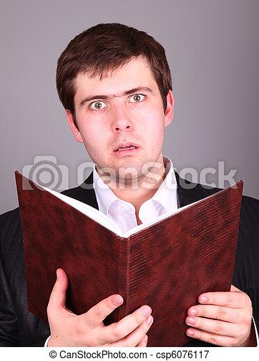Surprise Businessman with book - csp6076117