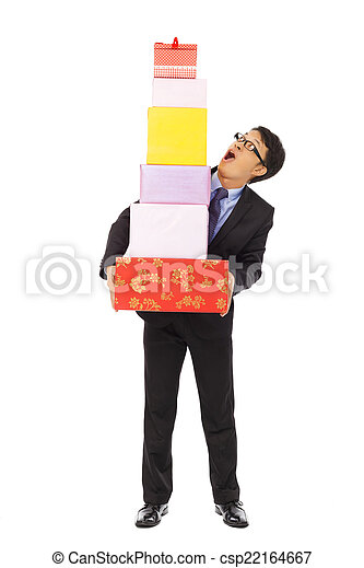 surprised businessman holding gift boxes . isolated on white bac - csp22164667