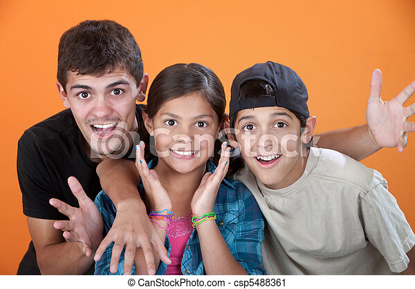 Surprised Siblings with Big Brother - csp5488361