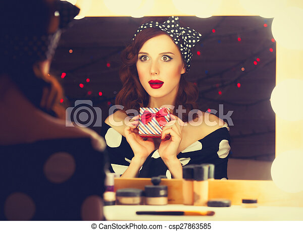 surprised woman with present box - csp27863585