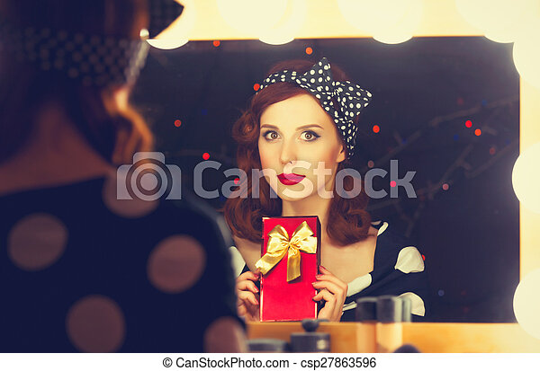 surprised woman with present box - csp27863596