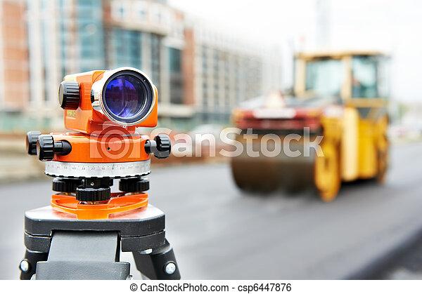 survey equipment at asphalting works - csp6447876