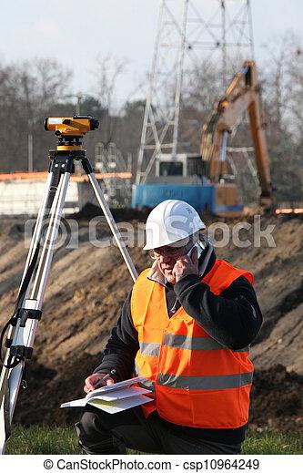 Surveyor at construction site - csp10964249