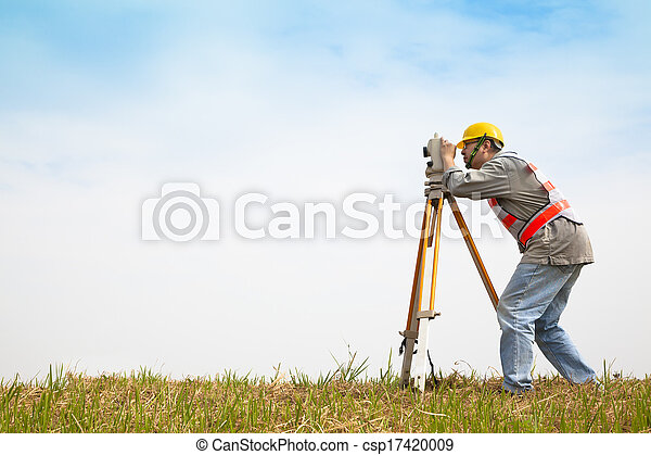 Surveyor engineer making measure on the field - csp17420009
