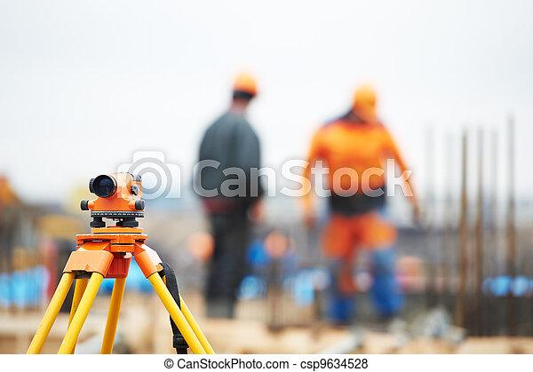 surveyor equipment level at construction site - csp9634528