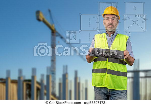 surveyor watching house digital project - csp63597173