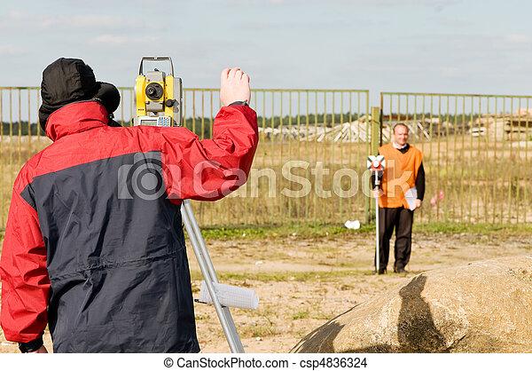 surveyor works with theodolite - csp4836324