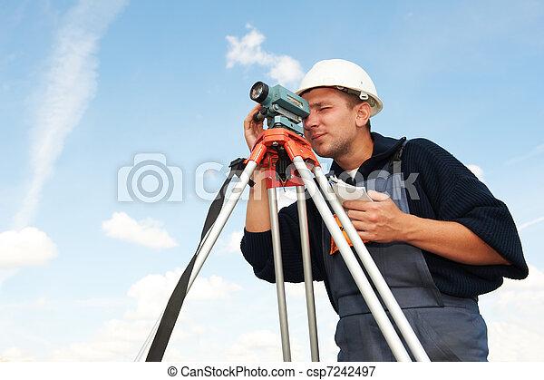 surveyor works with tilting level - csp7242497