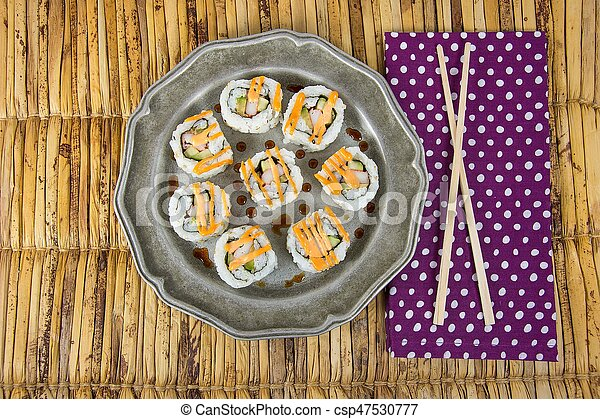 sushi pinwheel on pewter plate - csp47530777