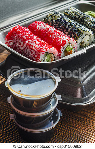 sushi rolls in a plastic thermo container - csp81560982