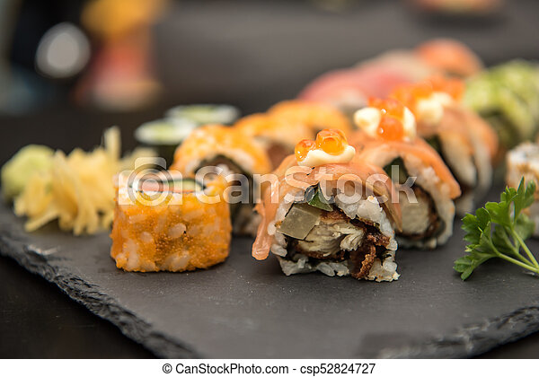 Sushi rolls on a black plate - csp52824727