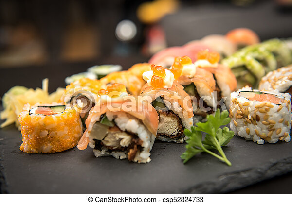 Sushi rolls on a black plate - csp52824733