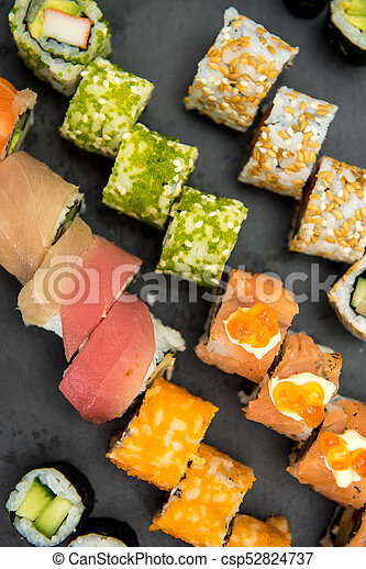 Sushi rolls on a black plate - csp52824737