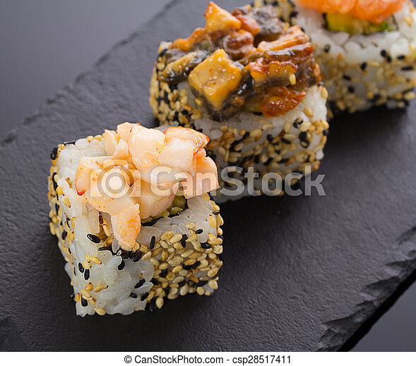 Sushi rolls on a stone plate - csp28517411