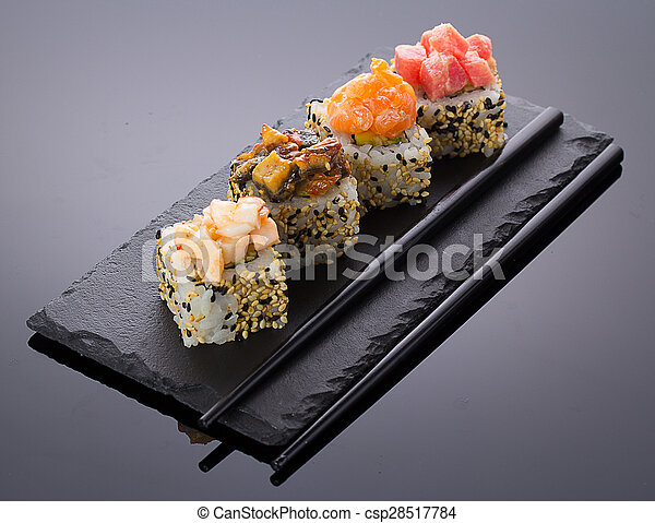 Sushi rolls on a stone plate - csp28517784