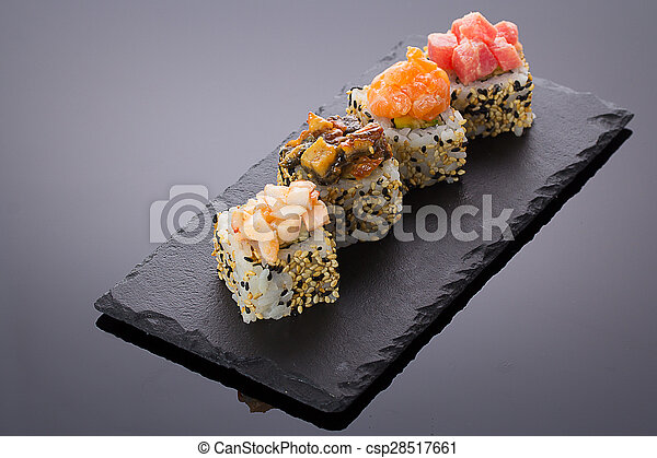 Sushi rolls on a stone plate - csp28517661