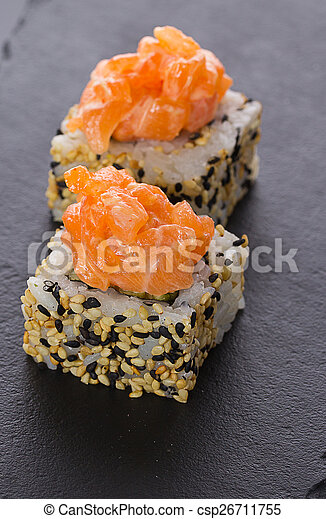 Sushi rolls on a stone plate - csp26711755