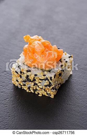 Sushi rolls on a stone plate - csp26711756