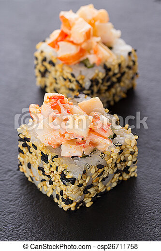 Sushi rolls on a stone plate - csp26711758