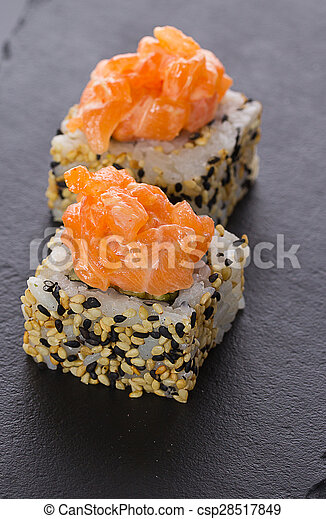 Sushi rolls on a stone plate - csp28517849