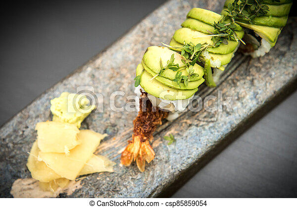 Sushi rolls with prawns on a stone plate - csp85859054