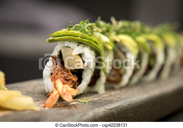 Sushi rolls with prawns on a stone plate - csp42238131