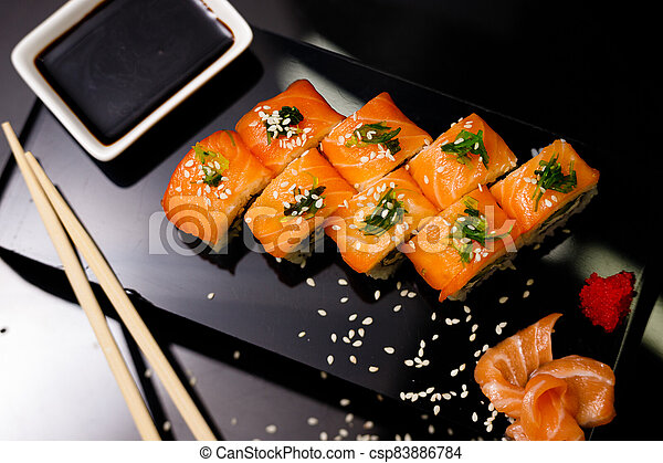 Sushi with salmon. Soy sauce, ginger, red caviar. Roles with red fish. - csp83886784