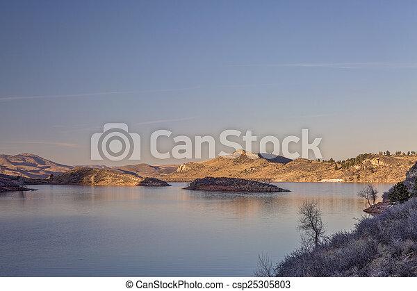 susnset over mountain lake - csp25305803